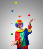 Clown juggling balls — Stock Photo