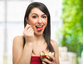 Woman eating a fruit cocktail — Stock Photo