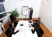 Businessman explaining business concepts — Stock Photo