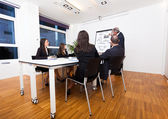 Man explaining business concepts — Stock Photo