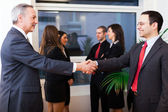 Businesspeople shaking their hands — Stock Photo