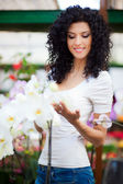 Woman looking at orchids — Stock Photo