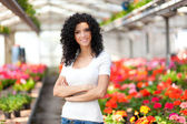 Woman in a greenhouse — Stock Photo