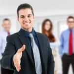 Businessman giving an handshake — Stock Photo