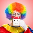 Stock Photo: Clown drinking from cup