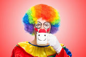 Clown drinking from a cup — Stock Photo