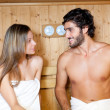Foto de Stock  : Couple having steam bath in sauna