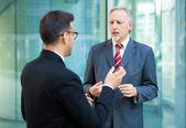 Businessmen talking — Stock Photo
