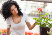 Woman looking to flowers — Stock Photo