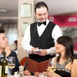 Couple ordering dinner in a restaurant — Stock Photo #41021105