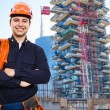 Worker in front of construction site — Stock Photo #41490777