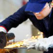 Worker grinding metal plate — Stock Photo #41491413