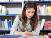 Girl in a library — Foto Stock
