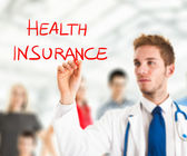 Doctor writing health insurance — Stock Photo