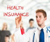 Doctor writing health insurance — Stock Photo
