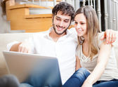 Couple using a laptop — Stock Photo