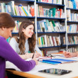 Stock Photo: People studying in a library