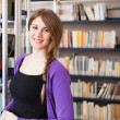 Woman in a library — Stock Photo