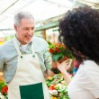 Stock Photo: Florist selling flowers to customer