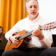 Stock Photo: Man playing an acoustic guitar