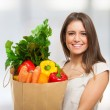 Woman holding a shopping bag — Stock Photo #41979449