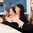 Stock Photo: Business people applauding