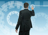 Businessman using a touchscreen interface — Stockfoto