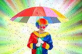 Clown enjoying a confetti rain — Stock Photo