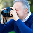 Man using his camera — Stock Photo