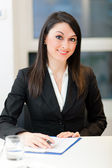 Businesswoman at her desk — Stock Photo