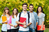 Happy students outdoor — Stock Photo