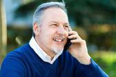 Senior man  talking on the phone — Stock Photo