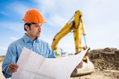 Architect at work in a construction site — Stock Photo