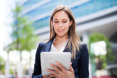 Business woman using a digital tablet — Stock Photo