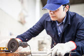 Worker using a grinder — Stock Photo