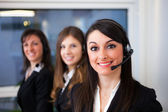 Smiling customer representative at work — Stock Photo