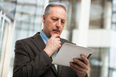 Business man using a touchpad — Stock Photo