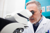Man using a microscope in a laboratory — Stock Photo