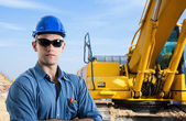 Man at work in a construction site — Stock Photo