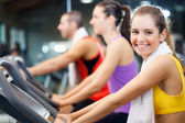 Group of people doing fitness in a gym — Stock Photo