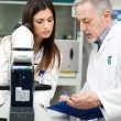 Scientists researching in a laboratory — Stock Photo