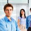 Young man in front of a group of people — Stock Photo #44647225