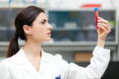 Woman researcher doing a blood test — Stock Photo