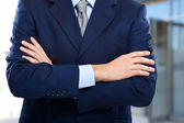 Crossed hands of businessman — Stock Photo