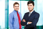 Businessmen with smile in office — Stock Photo