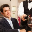 Waiter pouring wine — Stock Photo #45066625