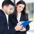 Business people discussing about documents — Stock Photo