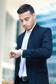 Businessman checking time on his watch — Stock Photo