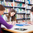 Students in a library — Stock Photo #45812779