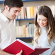 Students in a library — Stock Photo #45812785